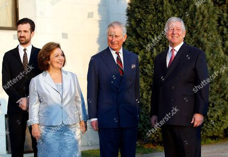 Heir to Serbia's defunct throne, Crown Prince Aleksandar Karadjordjevic, right, his wife Crown Princess Katherine, second left, and son Petar, left, pose with Britain's Prince Charles in the Royal Palace in Belgrade, Serbia, . The British royal couple are on an official visit to Croatia, Serbia, Montenegro and Kosovo