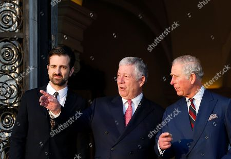 Heir to Serbia's defunct throne, Crown Prince Aleksandar Karadjordjevic, center and his son Petar, left, speak with Britain's Prince Charles in the Royal Palace in Belgrade, Serbia, . The royal couple is on official visits to Croatia, Serbia, Montenegro and Kosovo