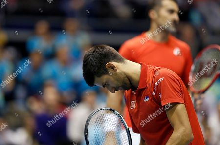 Serbia's Novak Djokovic, front and his partner Nenad Zimonjic react during their Davis Cup World Group first round doubles tennis match against Kazakhstan's Aleksandr Nedovyesov and Andrey Golubev, in Belgrade, Serbia