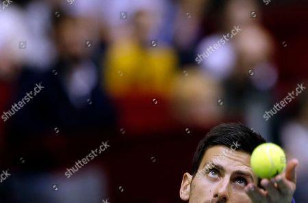 Stock Photo of Serbia's Novak Djokovic serves the ball during their Davis Cup World Group first round doubles tennis match against Kazakhstan's Aleksandr Nedovyesov and Andrey Golubev, in Belgrade, Serbia