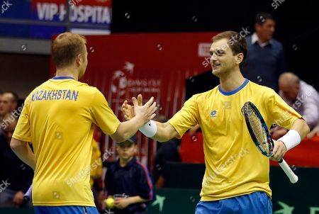 Kazakhstan's Aleksandr Nedovyesov, right, and his partner Andrey Golubev celebrate after their Davis Cup World Group first round doubles tennis match against Serbia's Novak Djokovic and Nenad Zimonjic, in Belgrade, Serbia