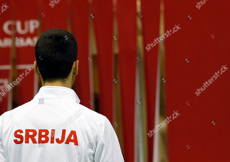 Serbia's Novak Djokovic leaves the pitch after the Davis Cup World Group first round doubles tennis match against Kazakhstan's Aleksandr Nedovyesov and Andrey Golubev, in Belgrade, Serbia