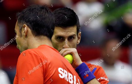 Stock Picture of Serbia's Novak Djokovic, right, and his partner Nenad Zimonjic talk between points during their Davis Cup World Group first round doubles tennis match against Kazakhstan's Aleksandr Nedovyesov and Andrey Golubev, in Belgrade, Serbia