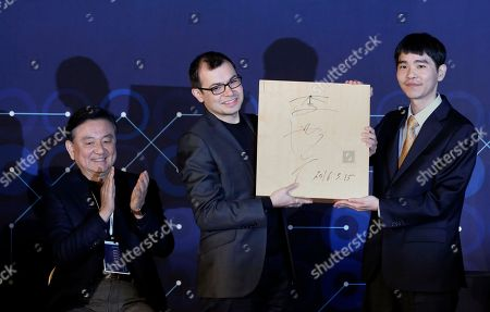 Demis Hassabis, Lee Sedol, Hong Seok-hyun Google DeepMind CEO Demis Hassabis, center, receives a Go board from South Korean professional Go player Lee Sedol, right, with his autograph as Korea Baduk (Go) Association Chairman Hong Seok-hyun, left, applauds during an award ceremony for the Google DeepMind Challenge Match against Google's artificial intelligence program, AlphaGo, in Seoul, South Korea, . Google's Go-playing computer program again defeated its human opponent in the final match on Tuesday that sealed its 4:1 victory
