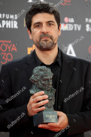 """Cesc Gay Spanish director Cesc Gay holds his Goya prize after winning the best direction award for his film """"Truman"""" at the Goya Film Awards Ceremony in Madrid, Spain, . The Goya Awards are Spain's main national annual film awards"""