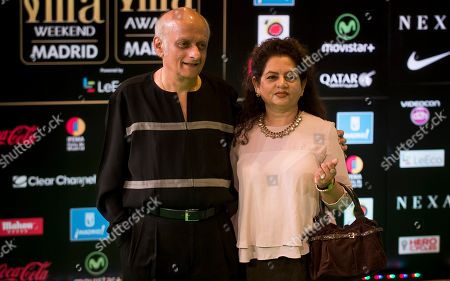 Mukesh Bhatt Bollywood producer Mukesh Bhatt, left, poses for photographers at the International Indian Film Academy (IIFA) Rocks Green Carpet for the 17th Edition of IIFA Weekend & Awards in Madrid, Spain