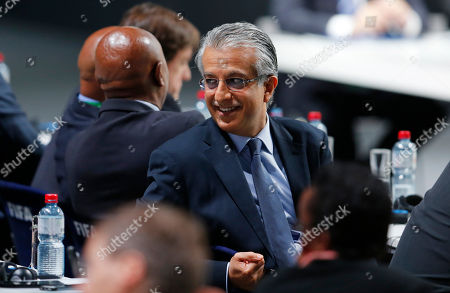 FIFA presidential candidate Sheikh Salman bin Ibrahim al-Khalifa of Bahrain smiles while the votes are counted during the extraordinary FIFA congress in Zurich, Switzerland, . Delegates of the soccer body FIFA meet to elect a new president