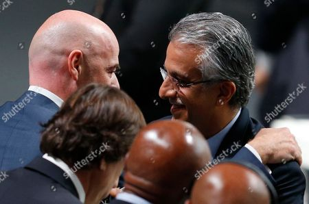 Newly elected FIFA President Gianni Infantino of Switzerland is congratulated by fellow candidate Sheikh Salman bin Ibrahim al-Khalifa of Bahrain, right, after the second election round during the extraordinary FIFA congress in Zurich, Switzerland