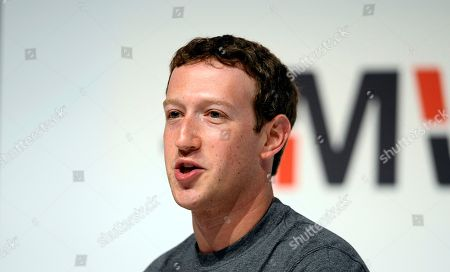"""Mark Zuckerberg Facebook CEO Mark Zuckerberg speaks during a conference at the Mobile World Congress, the world's largest mobile phone trade show in Barcelona, Spain. Zuckerberg is meeting with conservative leaders such as radio host Glenn Beck, to discuss claims that its """"trending topics"""" feature is biased against their viewpoints"""