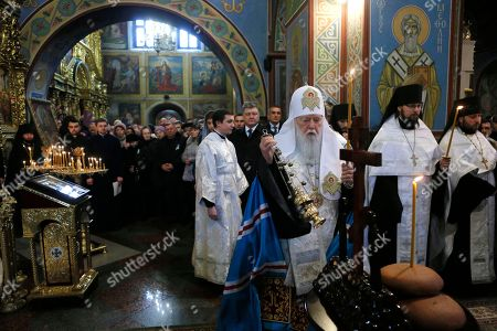 """The head of the Ukrainian Orthodox Church Patriarch Filaret conducts the memorial service for the """"Heavenly hundred"""" in the Mikhaylivsky Cathedral in Kiev, Ukraine, . The """"Heavenly Hundred"""" is what Ukrainians in Kiev call those who died during months of anti-government protests in 2013-14"""