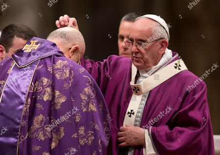 Pope Francis Pope Francis places ashes on the head of Cardinal Tarcisio Bertone during the Ash Wednesday mass, in St. Peter's Basilica at the Vatican, . Pope Francis has smudged ashes on the bowed heads of prelates, nuns and ordinary Catholics during Ash Wednesday Mass in St. Peter's Basilica. The ritual marks the start of Lent, a period of penitence, prayer and self-sacrifice as faithful prepare for Easter