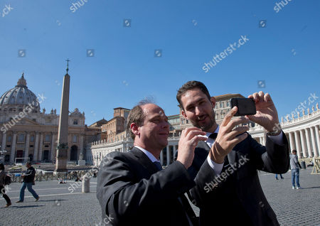 Kevin Systrom, right, CEO and co-founder of Instagram, takes a selfie with ABC News Eric Avram as he meets reporters in front of St. Peter's Square at the Vatican, . Pope Francis is expanding his presence on social media with an Instagram account. The pontiff, who has more than 26 million followers of his Twitter account, on Saturday launched his own account on the photo-sharing social network site Instagram. The pope's account will use the name @Franciscus, his name in Latin