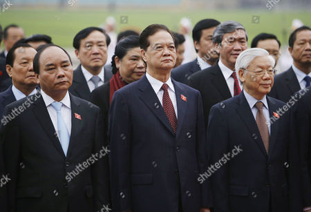 Nguyen Phu Trong, Nguyen Tan Dung, Nguyen Xuan Phuc Vietnam's Communist Party General Secretary Nguyen Phu Trong, right, Prime Minister Nguyen Tan Dung, center, Deputy Prime Minister Nguyen Xuan Phuc, left, and others pay tribute to late President Ho Chi Minh at his mausoleum in Hanoi, Vietnam