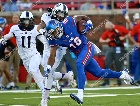 SMU receiver Courtland Sutton(16) fights for extra yards after catching pass against TCU defenders Ranthony Texada(11) and Tony James(28) during a NCAA college football game between TCU and SMU at Gerald J. Ford Stadium in Dallas Texas.TCU defeated SMU 33-3