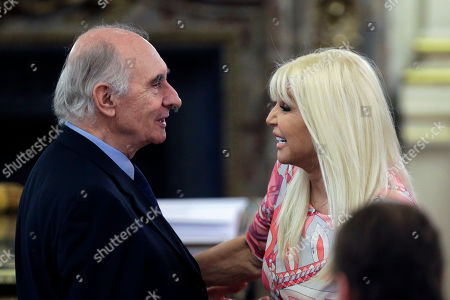 Stock Picture of Fernando de la Rua, Susana Gimenez Former Argentina President Fernando de la Rua, left, greets local TV star Susana Gimenez, right, during the inauguration ceremony of Argentina's new President Mauricio Macri at the government house in Buenos Aires, Argentina, . Macri, the former mayor of Buenos Aires who hails from one of Argentina's richest families, took the oath of office in Congress in front of legislators, several Latin American heads of state and other dignitaries