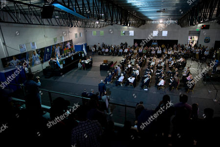Members of the Argentina Football Association, AFA, committee gather before voting for a new President, in Buenos Aires, Argentina, . The AFA committee will choose between famous TV presenter and San Lorenzo vice-president Marcelo Tinelli and Luis Segura, interim AFA leader, to replace Julio Grondona, who passed away in 2014, after being in charge of the entity for more than 35 years