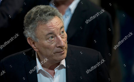 Luis Segura, interim leader of the Argentina Football Association, AFA, looks on before a meeting to vote for a new AFA president in Buenos Aires, Argentina, . The AFA committee will choose between famous TV presenter Marcelo Tinelli and Segura to replace Julio Grondona, who passed away in 2014, after being in charge of the entity for more than 35 years