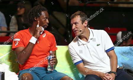 Gael Monfils of France, left, and Mats Wilander chat on the bench during his match against Nick Kyrgios of Australia during a Fast4 tennis tournament in Sydney, Australia