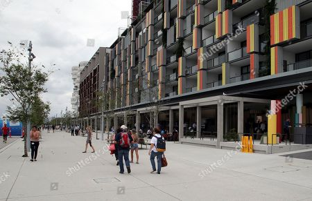 People walk along Barangaroo Ave, site for a new popup restaurant Noma Australia in Sydney, Australia, . Danish chef Rene Redzepi will open Noma Australia at Barangaroo on Australia Day 2016 and run for 10 weeks with all 5500 seats pre sold at a cost of $485 per person