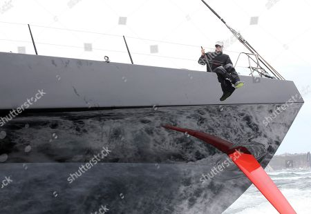 Former Australian model Kristy Hinze-Clarke sits on the rail of Comanche at the start of the Sydney Hobart yacht race in Sydney . The 628-nautical-mile race started in Sydney Harbour and is expected to end two to three days later in Hobart, the capital of the island state of Tasmania