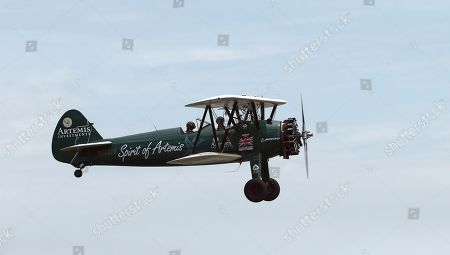 British aviator Tracey Curtis-Taylor flies her 1942 Boeing Stearman Spirit of Artemis aircraft into land at Sydney Airport in Sydney, Australia, . The 53 year-old aviator set out from Britain in October 2015 to recreate Amy Johnson's 1930 flight from Britain to Australia, a 13,000-mile solo flight in a vintage open cockpit biplane fling across 23 countries