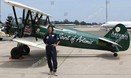British aviator Tracey Curtis-Taylor poses for a photo after she landed her 1942 Boeing Stearman Spirit of Artemis aircraft at Sydney Airport in Sydney, Australia, . The 53 year-old aviator set out from Britain in October 2015 to recreate Amy Johnson's 1930 flight from Britain to Australia, a 13,000-mile solo flight in a vintage open cockpit biplane fling across 23 countries