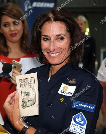 British aviator Tracey Curtis-Taylor receives a gift after she landed her 1942 Boeing Stearman Spirit of Artemis aircraft at Sydney Airport in Sydney, Australia, . The 53 year-old aviator set out from Britain in October 2015 to recreate Amy Johnson's 1930 flight from Britain to Australia, a 13,000-mile solo flight in a vintage open cockpit biplane fling across 23 countries