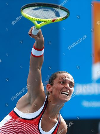 Stock Photo of Roberta Vinci Roberta Vinci of Italy serves to Tamira Paszek of Austria during their first round match at the Australian Open tennis championships in Melbourne, Australia