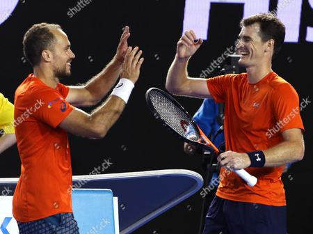 Jamie Murray, right, of Britain and Bruno Soares of Brazil celebrate after defeating Daniel Nestor of Canada and Radek Stepanek of the Czech Republic the men's doubles final at the Australian Open tennis championships in Melbourne, Australia, early