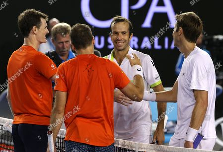 Jamie Murray, left, of Britain and Bruno Soares, second left, of Brazil celebrate after defeating Daniel Nestor, right, of Canada and Radek Stepanek of the Czech Republic the men's doubles final at the Australian Open tennis championships in Melbourne, Australia, early