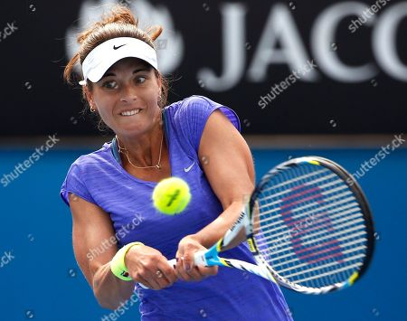 Petra Cetkovska of the Czech Republic makes a backhand return to Sabine Lisicki of Germany during their first round match at the Australian Open tennis championships in Melbourne, Australia