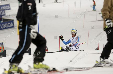 Germany's Felix Neureuther lies on the snow after skiing off-course during an alpine ski, men's World Cup slalom, in Schladming, Austria, . Khoroshilov finished in third place