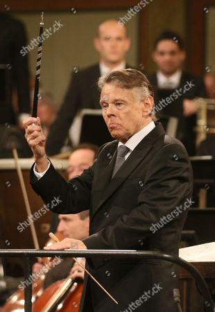 Latvian Maestro Mariss Jansons shows his new conductor's baton he received during the traditional New Year's concert with the Vienna Philharmonic Orchestra at the golden hall of the Musikverein in Vienna, Austria