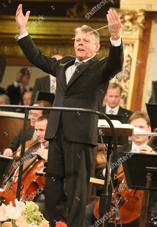 Latvian Maestro Mariss Jansons conducts the Vienna Philharmonic Orchestra during the traditional New Year's concert at the golden hall of the Musikverein in Vienna, Austria