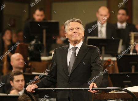 Latvian Maestro Mariss Jansons welcomes the audience at the beginning of the traditional New Year's concert with the Vienna Philharmonic Orchestra at the golden hall of the Musikverein in Vienna, Austria