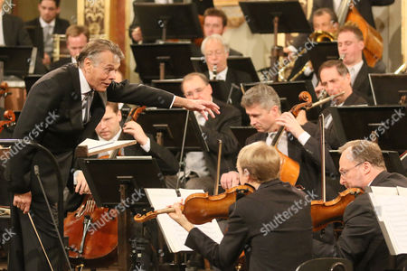 Latvian Maestro Mariss Jansons, left, conducts the Vienna Philharmonic Orchestra during the traditional New Year's concert at the golden hall of the Musikverein in Vienna, Austria