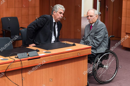 Wolfgang Schauble, Hans Jorg Schelling Germany's Finance Minister Wolfgang Schauble, right, talks with Austria's Finance Minister Hans Jorg Schelling during a Eurogroup finance ministers meeting at the EU Council building in Brussels