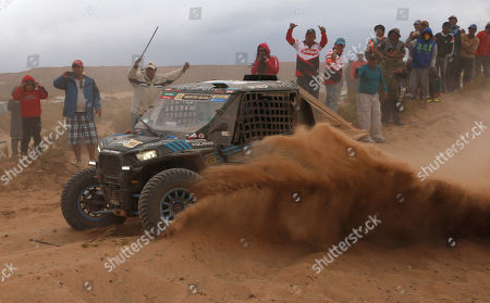 Eugenio Amos, Rafael Tornabell Polaris driver Eugenio Amos, of Italy, and co-driver Rafael Tornabell Cordova, of Spain, race during the fifth stage of the Dakar Rally between the cities of Jujuy, Argentina and Uyuni in Uyuni, Bolivia