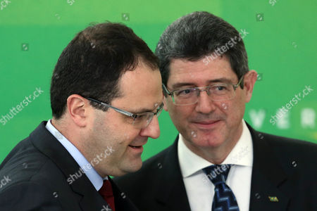 Nelson Barbosa, Joaquim Leby Brazil's new Economy Minister Nelson Barbosa, left, greets the man he's replacing, Joaquim Levy, during his swearing-in ceremony at Planalto presidential palace in Brasilia, Brazil, . The swap comes amid Brazil's worst recession in 25 years, as a mushrooming corruption scandal and political crisis continue to hamper recovery efforts