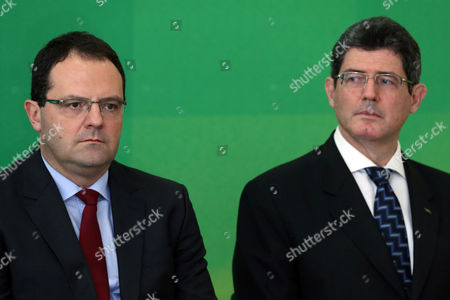 Nelson Barbosa, Joaquim Levy Brazil's new Economy Minister Nelson Barbosa, left, stands near the man he's replacing, Joaquim Levy, during the incoming minister's swearing-in ceremony, at Planalto presidential palace in Brasilia, Brazil. The swap comes amid Brazil's worst recession in 25 years, as a mushrooming corruption scandal and political crisis continue to hamper recovery efforts