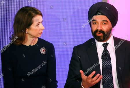 Sir Harpal S. Kumar, Chief Executive of Cancer Research UK, right, speaks alongside Helena Morrissey, Chief Executive Officer of Newton Investment Management, left, during a press conference in London, . BNY Mellon and Newton Investment Management, sponsors of The Boat Races, announced Tuesday that they are donating their title sponsorship of the annual challenge between Oxford and Cambridge Universities to Cancer Research UK (CRUK), the official charity partner