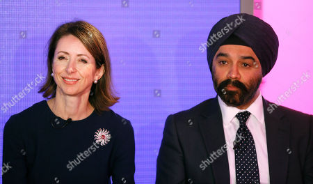 Helena Morrissey, Chief Executive Officer of Newton Investment Management, left, speaks alongside Sir Harpal S. Kumar, Chief Executive of Cancer Research UK, right, during a press conference in London, . BNY Mellon and Newton Investment Management, sponsors of The Boat Races, announced Tuesday that they are donating their title sponsorship of the annual challenge between Oxford and Cambridge Universities to Cancer Research UK (CRUK), the official charity partner