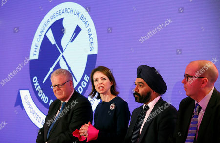 Helena Morrissey, Chief Executive Officer of Newton Investment Management, second left, speaks alongside Sir Harpal S. Kumar, Chief Executive of Cancer Research UK, second right, David Searle, Executive Director of The Boat Race Company Ltd, right, and Michael Cole-Fontayn, Chairman Europe, Middle East and Africa of The Bank of New York Mellon, left, during a press conference in London, . BNY Mellon and Newton Investment Management, sponsors of The Boat Races, announced Tuesday that they are donating their title sponsorship of the annual challenge between Oxford and Cambridge Universities to Cancer Research UK (CRUK), the official charity partner
