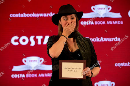 The overall winner and winner of the children's book category Frances Hardinge, for her book 'The Lie Tree', reacts as she poses on stage after receiving her award at the Costa Book Awards in London