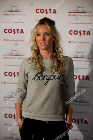 British radio presenter and actress Clemency Burton-Hill poses for photographers at the Costa Book Awards in London