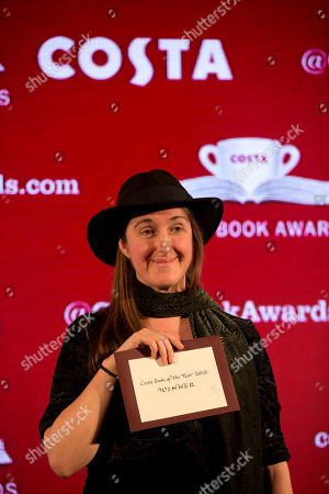 The overall winner and winner of the children's book category Frances Hardinge, for her book 'The Lie Tree', poses on stage after receiving her award at the Costa Book Awards in London