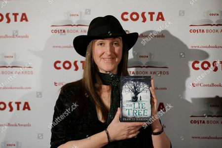 The winner of the children's book category Frances Hardinge poses for photographs with her book 'The Lie Tree' at the Costa Book Awards in London