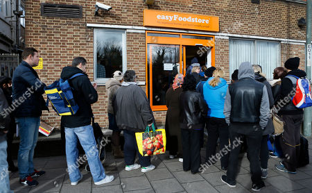 People queue outside the EasyFood store in London, . The founder of budget airline EasyJet has stepped into Britain's grocery aisle. Stelios Haji-Ioannou has opened a discount grocery in northwest London, called EasyFood, offering canned sardines, soups and pasta for a mere 25 pence (36 cents) _ for a limited time only
