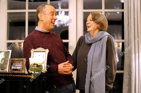 """British actress Dame Maggie Smith and director Nicholas Hytner chat at a hotel in London, . Smith has shed her """"Downton Abbey""""-era corsets and hats to play an eccentric elderly vagrant in the film """"The Lady in the Van"""", in which Smith plays Miss Shepherd, a real-life homeless woman who parked in the driveway of writer Alan Bennett's London house, and stayed for 15 years"""