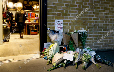 """Tributes to British Actor Alan Rickman are left outside the Platform 9 and three quarters shop at Kings Cross station in London, . British actor Alan Rickman, whose career ranged from Britain's Royal Shakespeare Company to the """"Harry Potter"""" films, has died. He was 69. Rickman's family said Thursday, Jan. 14, 2016 that the actor had died after a battle with cancer"""
